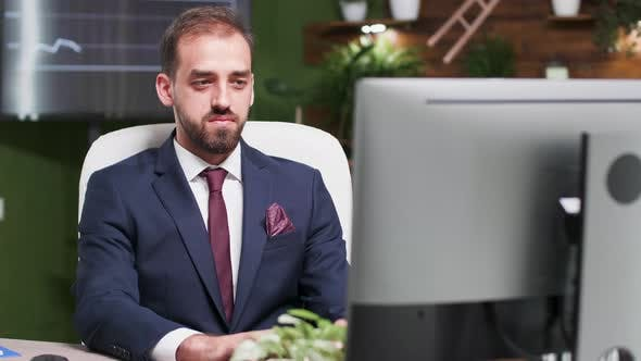 Thumbnail for Confident Office Worker Typing on the Computer and Smiling