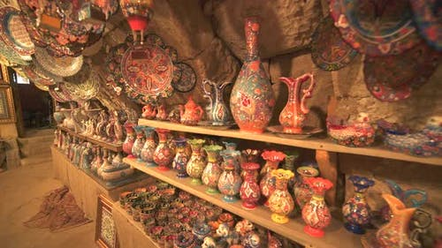 Porcelain And Pots For Sale on The Shelves in The Handmade Artistic Pottery Shop
