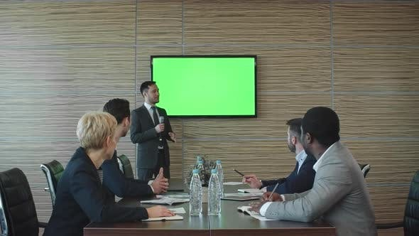 Thumbnail for Businessman Presenting Something at Meeting