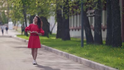 Young Woman is Enjoying Good Weather and Freedom at Summer Vacation