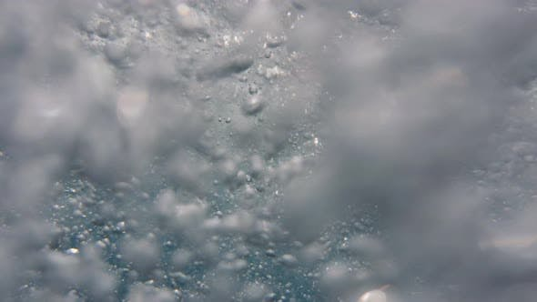 close-up view of air bubbles in the ocean water