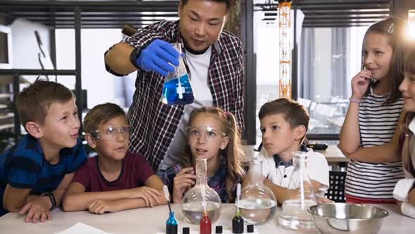 Thumbnail for Teacher Shows Young Students Chemical Experiment in Class