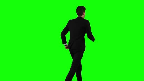 Thumbnail for Businessman Is a Telephone Rings To Him and He Talks. Green Screen