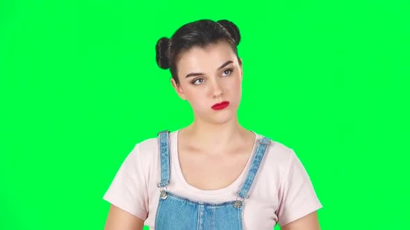 Cover Image for Girl Stands Waiting on a Green Screen. Slow Motion