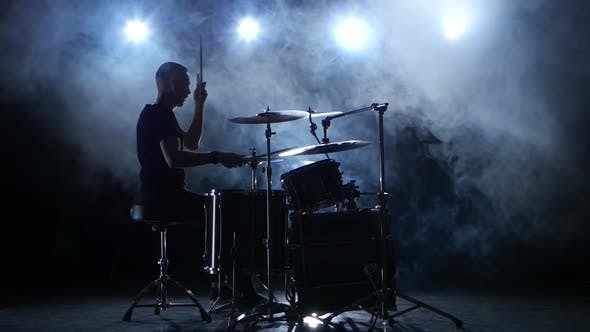 Thumbnail for Energetic Musician Plays Good Music on Drums. Black Smoky Background