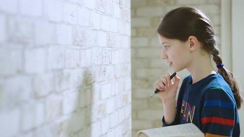 School Girl Doing Maths on Wall