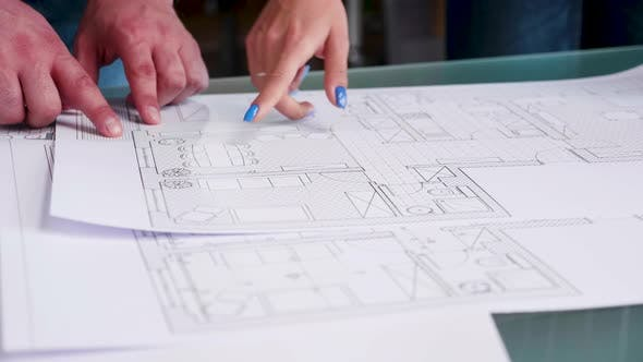 Thumbnail for Close Up Hands of Architects Pointing on Blueprints