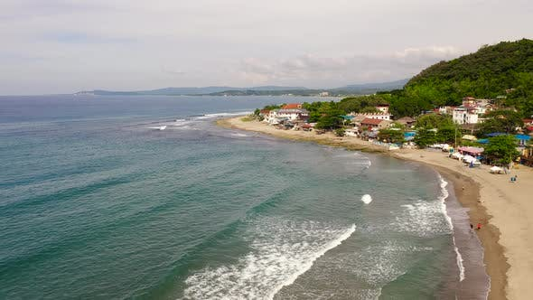 Thumbnail for Sandy Coast, Buildings and Blue Sea with Waves. San Juan, La Union, Philippines