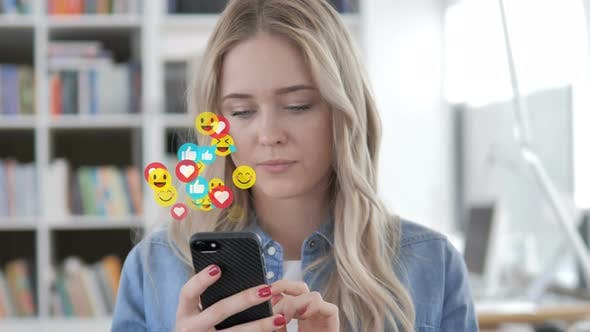 Thumbnail for Blonde Woman Watching a Live Stream on Smartphone
