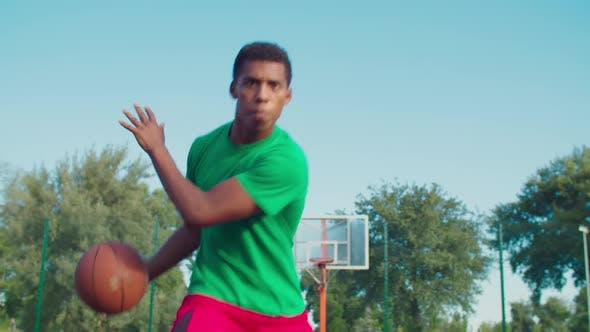 Thumbnail for Athletic Black Man Playing Basketball Outdoors