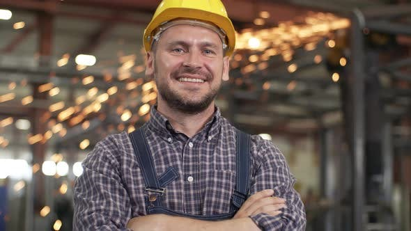 Thumbnail for Smiling confident engineer standing in workshop