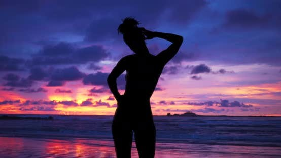 Thumbnail for Single silhouette of sensual woman standing on sunset beach in Hawaii.