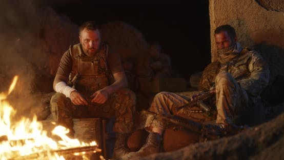 Thumbnail for Angry Military Men Resting Near Fire