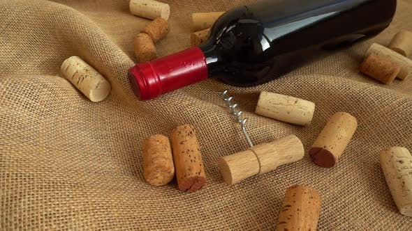 Thumbnail for Wine in bottles and falling corks on the bag. Slow motion