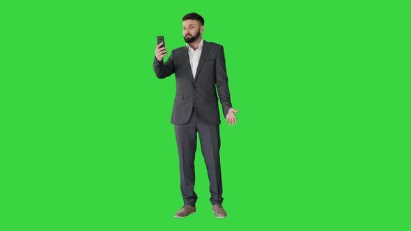 Thumbnail for Handsome Turk Businessman Making a Video Call with His Smartphone on a Green Screen, Chroma Key