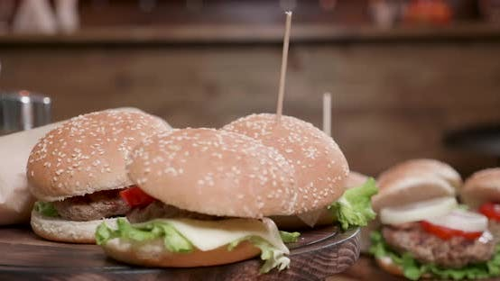 Thumbnail for Burgers Smooth Rotation on a Wooden Stand