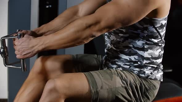 Thumbnail for Muscular Strong Man Training Hands and Back Exercising on Rowing Sport Machine Workout Gym