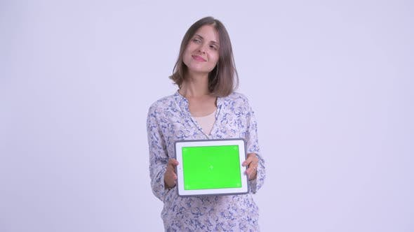 Thumbnail for Happy Young Pregnant Woman Thinking While Showing Digital Tablet
