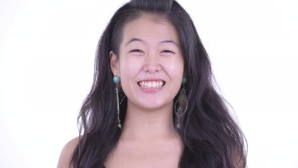 Thumbnail for Face of Happy Beautiful Asian Woman Smiling Ready To Party