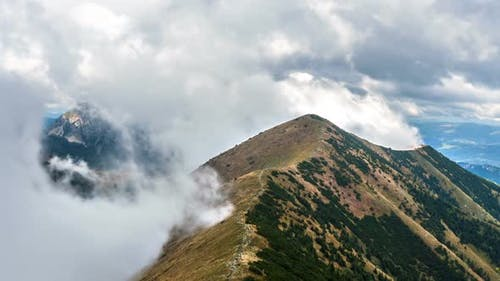 Clouds Moving Fast in Mountains in Alps Landscape