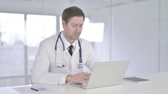 Cover Image for Middle Aged Doctor Saying No with Finger Sign in Office