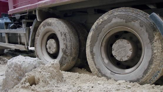 Thumbnail for The Wheels of a Truck Go Through a Swamp at a Construction Site. Close Up