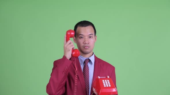 Cover Image for Face of Angry Asian Businessman Using Telephone and Shouting