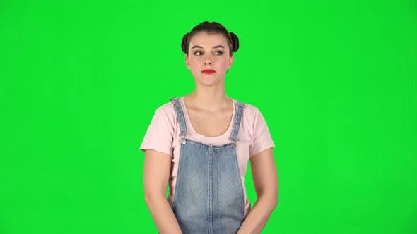 Thumbnail for Playful Girl Funny Coquetting and Blowing a Kiss on Green Screen