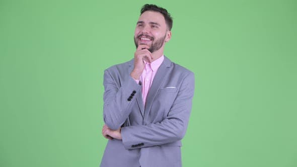 Thumbnail for Happy Young Bearded Businessman Thinking and Looking Up