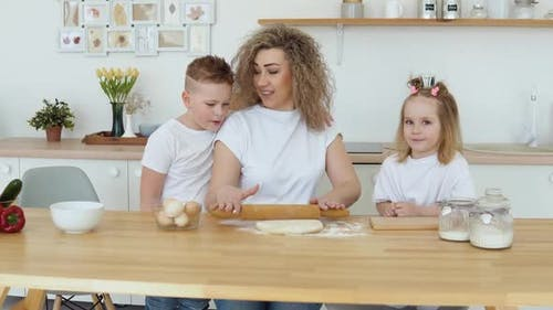 Family of Caucasian Blondes in White Tshirts