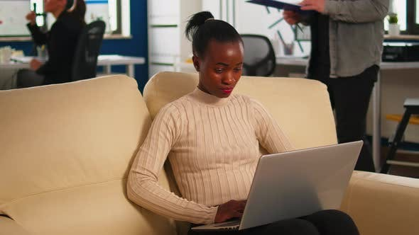 Thumbnail for Concentrated African Business Woman Answering Emails Typing on Laptop