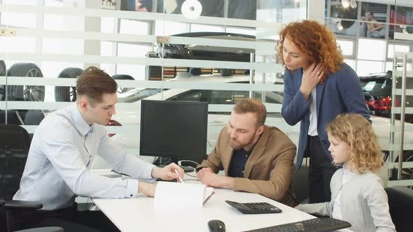 Consultant and Customers in Dealership