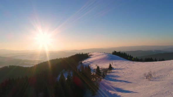 Thumbnail for Aerial View in Sundown Winter Mountain