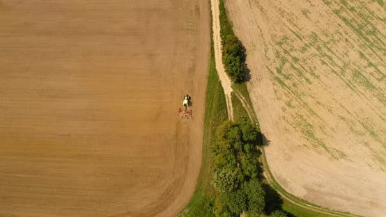 Thumbnail for Aerial View of Tractor Plowing Field