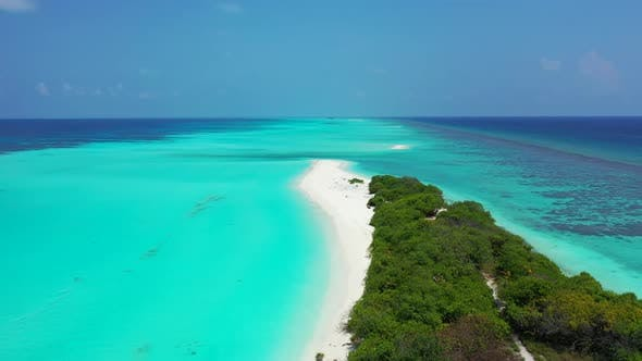 Thumbnail for Aerial seascape of tropical seashore beach vacation by aqua blue lagoon with white sand background o