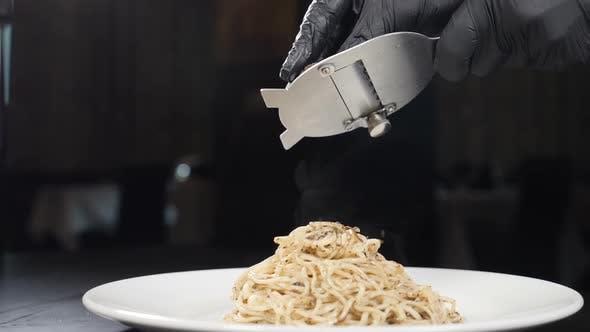 Thumbnail for Chef Grates Black Truffle on Pasta in Italian Restaurant. Slow Motion. Concept of Gourmet Cuisine