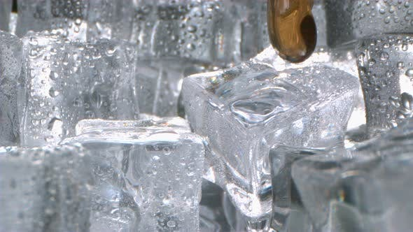 Thumbnail for Whiskey With Ice Pouring In A Glass In High Speed Motion