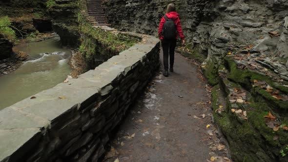 Female Tourist Walking Through Watkins Glen State Park Natural Gorge