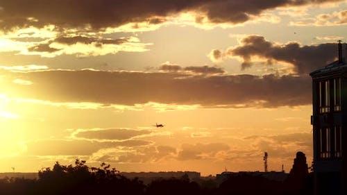 Airplane is Landing at Sunset