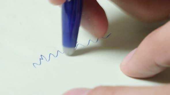 Thumbnail for Contemporary erasable pen with close-up writting and erasing 4K 2160p 30fps UltraHD footage - Closeu