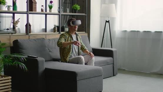 Thumbnail for Man Enjoys 360 Video, Wearing Virtual Reality Headset at Home,