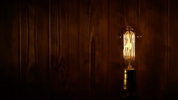 Thumbnail for Edison Light Bulb on Wooden Background