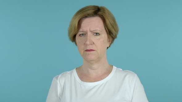 Thumbnail for Sad  Old Woman Isolated on Blue Background