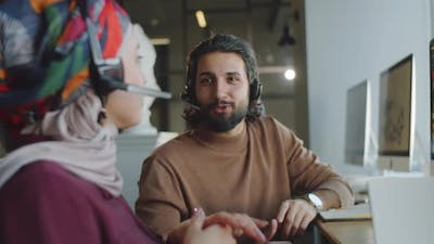 Muslim Call Center Agents Chatting at Work