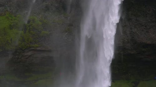Water Flows Down a Powerful Stream at a Waterfall
