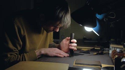 Tanner Working in Workshop