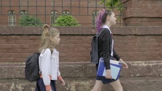 Thumbnail for Two Girls Going To School, Children in School Uniform with Backpacks