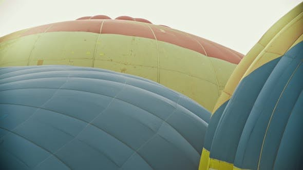 Thumbnail for Tops of Huge Colorful Air Balloons Filling with Hot Air