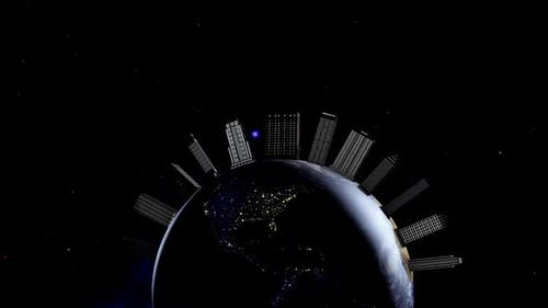 Night planet is the earth in space. Animation of large buildings appearing on the planet