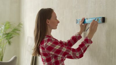 Young Woman Using Construction Level